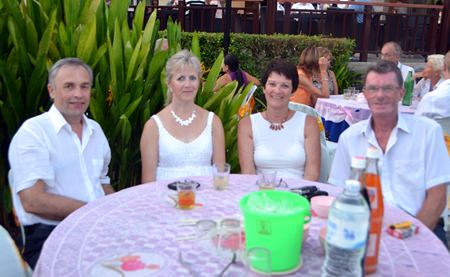(L to R) Johs Stokkeuas, Solveig Stokkeuas, Turid Eksund and Oddgeir Sanclo enjoy the anniversary party.