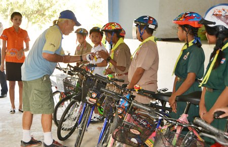 Rick personally instructs the children on safety while riding their bikes.