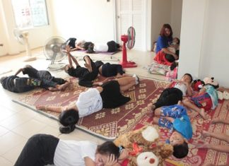 Children try out one of the unfinished new spacious bedrooms at the Baan Jing Jai Home.