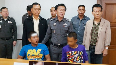 Two of the four accused rapists are brought out for the press.