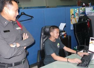 Sattahip police turn over their computer to help 13-year-old Phasit Ditaem find his family via Facebook.
