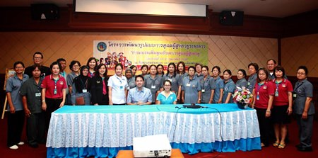 Mayor Itthiphol Kunplome and Supaporn Cherdchaipoom, director of the Pattaya Public Health Office (both seated, center) preside over a five-day workshop which aimed to enhance skills in the care of the elderly.