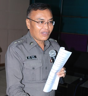 Pol. Lt. Col. Peerapus Sornbootdee, deputy superintendent of the crime suppression division at Nongprue Police Station, conducts the training of Nongprue residents who want to become civil-defense volunteers.