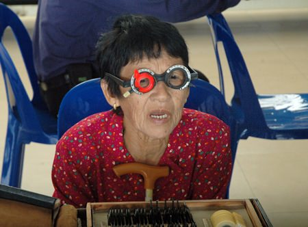 Riam Saengo, 89, has an eye exam because she cannot see her TV programs clearly.