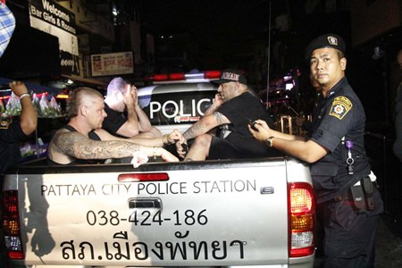Three bar customers are taken to the police station for further questioning after a bar brawl in Soi LK Metro.