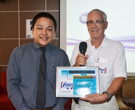 MC Richard Silverberg presents the PCEC's Certificate of Appreciation to Dr. Ping.