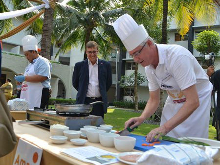Amari Pattaya GM Brendan Daly gets to work cooking an egg and vegetable fried rice dish.
