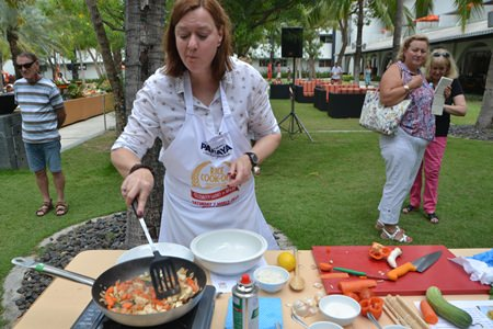 PILC President Helle Rantsen expertly prepares her fried rice dish.