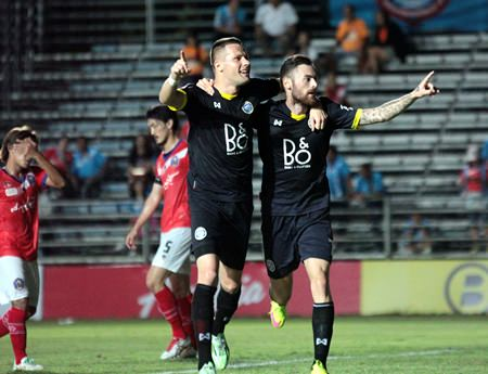Pattaya United's Nikola Komazec (left) and Milan Bubalo (right) of Serbia celebrate the latter's goal during first half stoppage time of their Thai Division 1 fixture against Samut Songkhram FC at the Nongprue Stadium in Pattaya, Sunday, March 8.