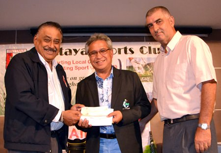 PSC President Peter Malhotra (left) presents a cheque for 100,000 baht to Mike, President of the EGA (centre) for the EGA Caddy Championship 2015 as Golf Chairman Mark West (right) looks on.