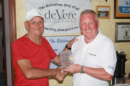 Robbie Taylor (left) receives the deVere trophy from Brian Chapman.