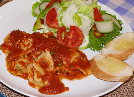 Minced pork and three mushrooms ravioli with a pomodoro sauce.