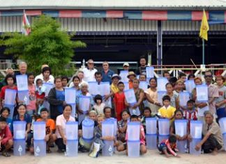 Members of TFi and the Rotary Club Of Eastern Seaboard present portable water filters to some of the most impoverished members of the local community.