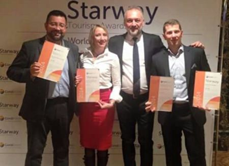 Victor Krivenstov, director of sales and marketing for the Royal Cliff Hotels Group, receives the prestigious Starway World Best Hotels Award during the Intourmarket (ITM) 2015 Travel Fair in Moscow, Russia.