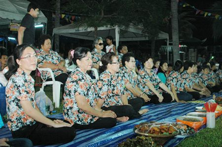 "The residents from Soi Post Office wore colorful flower ""team"" shirts."