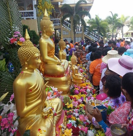 "Many residents joined the more traditional ""Song Nam Pra"" ceremony at Wat Samakee Pracharam."