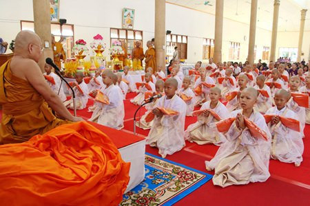 61 novices prepare to be ordained by Tasanee Kunakorn, abbot of Sattahip Temple.