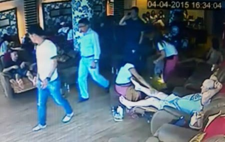 The alleged extortionists were caught on the massage shop's CCTV cameras.