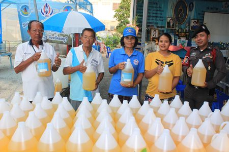 Residents of Kophai Community proudly show off their home made kaffir lime dish washing liquid.