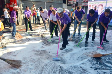 Mayor Itthiphol Kunplome leads local leaders and city workers in scrubbing down Walking Street.
