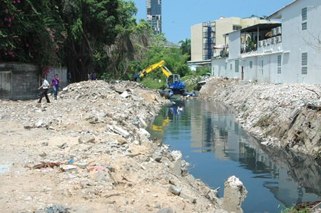 Workers clear out debris from the inland side of the canal. Deputy Mayor Verawat Khakhay predicts the remaining demolition would be complete before the rainy season.