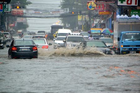 An unseasonably strong tropical storm brought hours of heavy rain to Pattaya last week, flooding many areas throughout the city.  Shown here, the flash flood paralyzed traffic on Pattaya Center Road, with meter deep water from the Central Pattaya market to Pattaya Beach.