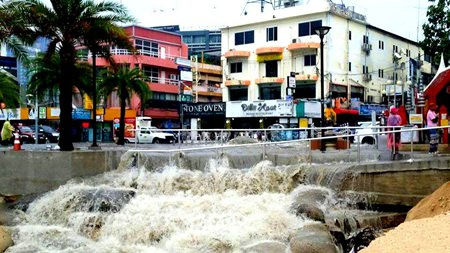 Flood waters rip apart concrete barriers protecting Pattaya Beach.