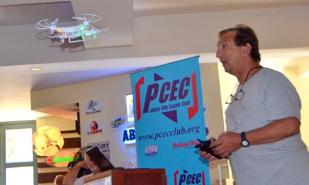 Paul Rosenberg shows his PCEC audience one of the remote-controlled quad-copters he brought with him. He noted that this particular model is manufactured here in Pattaya was not expensive and could be fitted with a camera. With a monitor affixed to the remote control device, it is almost like being on board as you soar through the air.
