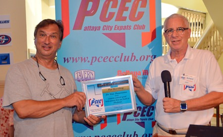 Master of Ceremonies Richard Silverberg presents the PCEC's Certificate of Appreciation to Paul Rosenberg for his interesting talk and demonstration of remote-control aircraft.