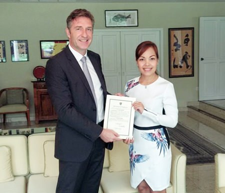 HE Ambassador Enno Drofenik presents Sriwanna Jitprasert with her certificate of appointment.