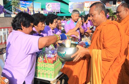 Residents of Nongprue take part in the merit making activities, presenting alms to 61 Buddhist monks.
