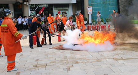 Fire police officers provide basic fire fighting training to employees of the Central Festival Pattaya Beach.