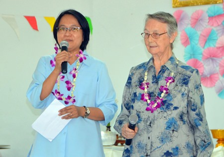 Sister Jiemjit Thumpichai and Sister Joan Gormley welcome guests to the Songkran activities at the Fountain of Life Center Pattaya.