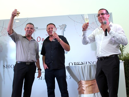 Developers (l-r) Raz Shai, Rony Fineman and Miki Haim raise a toast during the opening of The Orient Jomtien Resort & Spa showrooms on March 20.