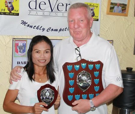 Jittina 'Orn' Tinpranee (left) receives the deVere overall winner's trophy and shield from Brian Chapman.