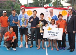 Vitanart Vathanakul, Executive Director of the Royal Cliff Hotels Group (5th from left), Antonello Passa, General Manager of the Royal Cliff Hotels Group (right) and Kritsana Sorahong, the Fitz Club –Racquets, Health & Fitness Manager (left kneeling) congratulate all the winners and finalists of the 5th Fitz Club Tennis Tournament on April 6.