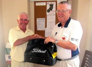 Dick Warberg (right) congratulates Dave Cooper – the MBMG Group Golfer of the Month.