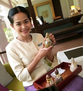 Wipada Tuenwong shows off various scents of massage oil, from lavender to chamomile to lemon grass, all to suit your needs and mood.