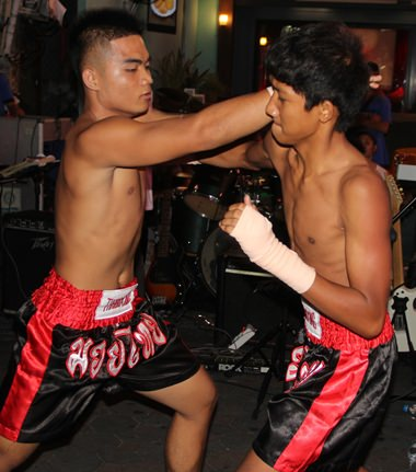 The Muay Thai exhibition was staged, but the fighters were cheered by the crowd.