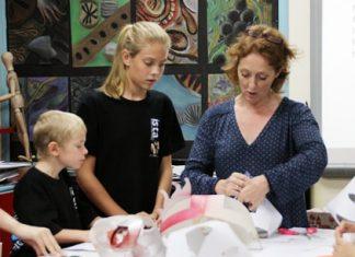 Art teacher Clare Spear leads the mask making workshop.