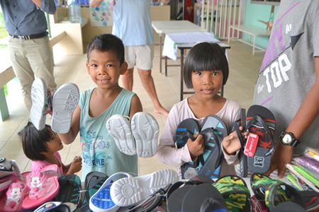 Children really enjoy getting new shoes.
