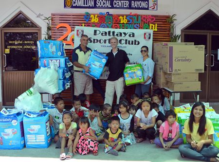 PSC Golf Chairman Mark West, Camillian Volunteer Jimmy Juergen, and PSC Charity Chairperson Noi Emmerson hand over basic necessities for HIV/AIDS patients under the care of Camillian Social Center Rayong.