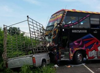 The driver and passenger were injured when their pickup was struck by a tour bus in Huay Yai.