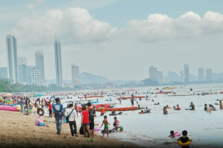 Jomtien Beach was packed on Labor Day by Thai tourists escaping the rain and heat of Bangkok, and factories in Chonburi and nearby provinces.