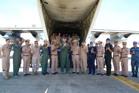 U.S. Air Force Brig. Gen. Michael Minihan (center left) and Royal Thai Navy Rear Adm. Graisrl Gesom (center right) visit the site of the pallet load and thank everyone involved with the mission.