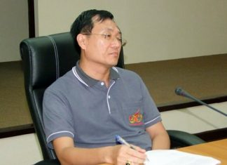 Chonburi Deputy Mayor Chamnanwit Taerat leads a meeting to plan how Chonburi will mark Monday's Visakha Bucha holiday.