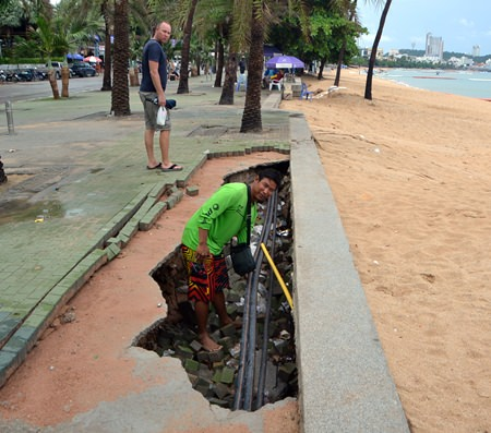 Speedboat captain Weerayuth Boonkaya points out the holes in the recently rebuilt beach promenade are particularly dangerous, especially at night.