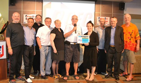 Master of Ceremonies Richard Silverberg presents Mara Swankey and Pattaya Players with the PCEC's Certificate of Appreciation for an informative and entertaining presentation.