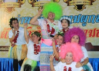 Father Phu with a green wig and his dancers.