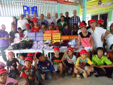 Members of the Foreign Anti-Narcotics Community Thailand donate school uniforms and other supplies to the Anti-Human Trafficking and Child Abuse Center.